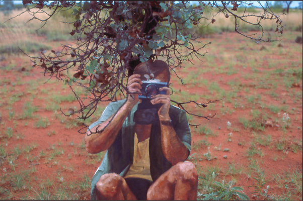 shooting the natives in situ cut-out life-sized figure, farmland opposite native land, pilbara region